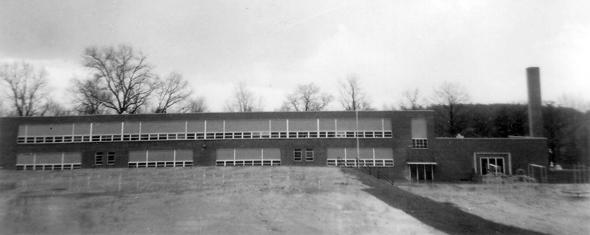 Black and white photograph of the front exterior of Willston Elementary School.