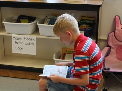 photo of boy reading